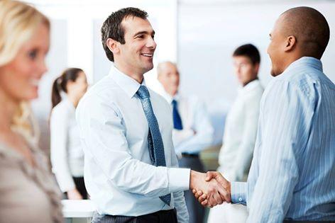 shaking hands work professionals