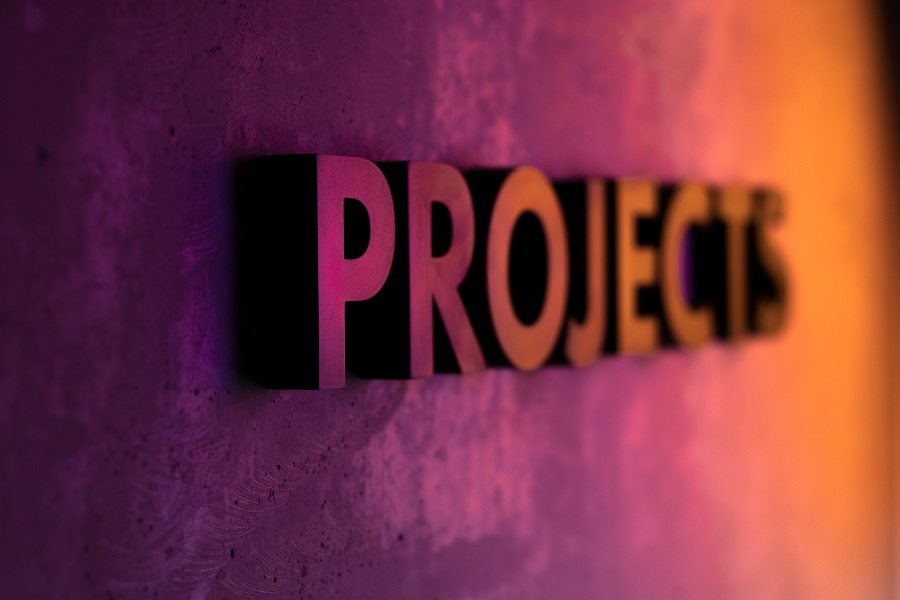 Purple wall that says PROJECTS