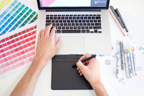 Freelance Graphic Design professional using computer to draw and view colors